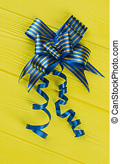 Blue striped bow for presents.