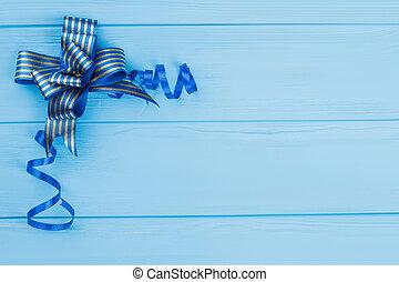 Blue striped bow ribbon.