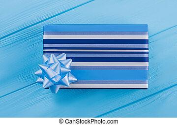 Blue striped gift box.