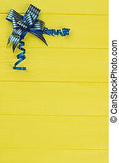 Blue striped gift ribbon bow.