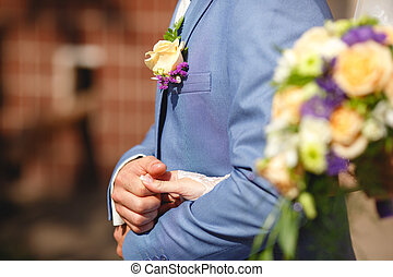 Blue suit and wedding boutonniere