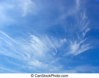 Blue summer sky and white high cirrus fluffy clouds