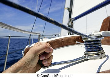Blue summer water and sky in a sailboat race, sailor man in...