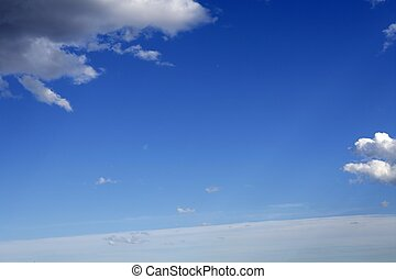 blue sunny day sky with clouds