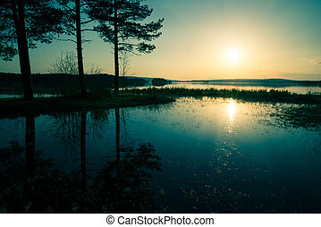 blue sunset over the lake that overflowed