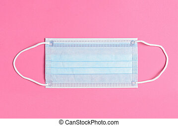 Blue Surgical Mask on a Pink Background, High angle view.