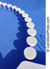 blue swimming pool round tiles crossing way summer vacation background