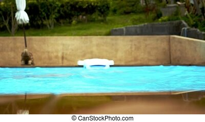 Blue Swimming Pool with Rippled Water. Slow Motion.