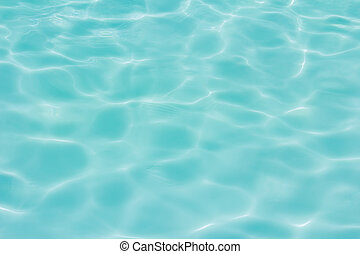 Blue swimming pool with sunny reflections background