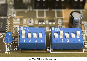 blue switches on circuit board