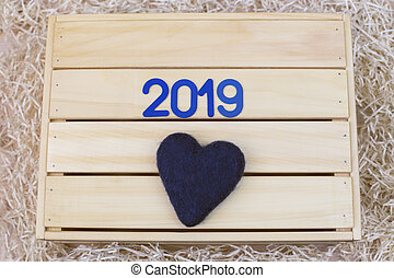 Blue symbol with and a heart on a wooden background