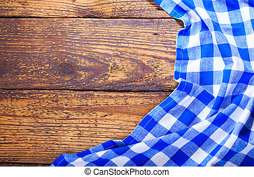 blue tablecloth on wooden table