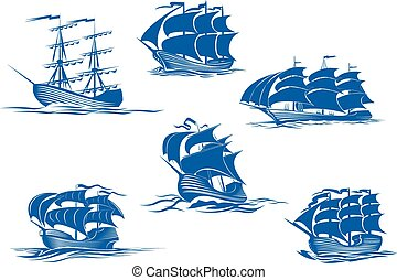 Blue tall ships or sailing ships, one with its sails stowed...