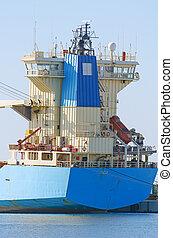 Blue tanker ship in dock.