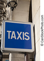 Blue Taxi Sign in Paris Street, France