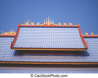 """Blue temple roof at temple called """"Wat Pipat Mongkol"""" or """"The golden buddha's Building"""", Thungsaliam, Sukhothai, Thailand in 26 February 2021."""