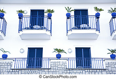 Blue terraces of an italian mediterranean building