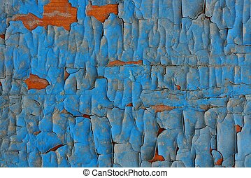 blue texture of shabby paint in the cracks on the old board
