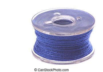 Blue Thread Bobbin Macro Isolated