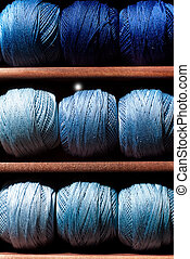 Blue threads - Close-up on blue thread reels in a...