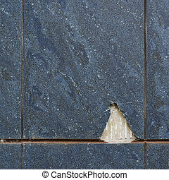Blue old tile with a chipped piece as a texture background