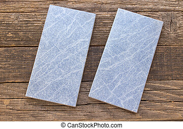 Blue tiles on wooden background