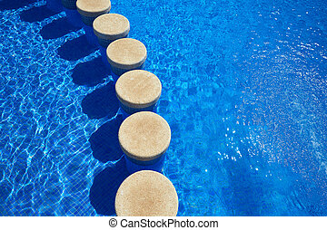 Blue tiles swimming pool water texture