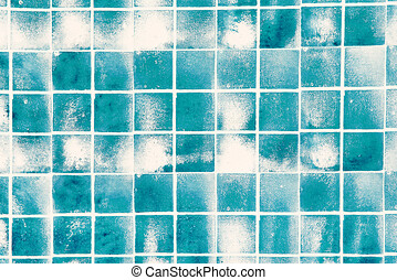 Blue tiles with white borders and stains