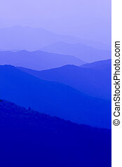 The blue haze that hovers over the Great Smoky Mountains range. This natural landscape of the layered mountains makes for a great background image.