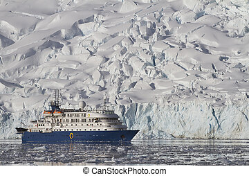 blue tourist ship on the background of a summer day glaciers