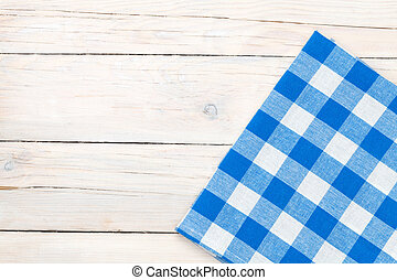 Blue towel over wooden kitchen table. View from above with copy space