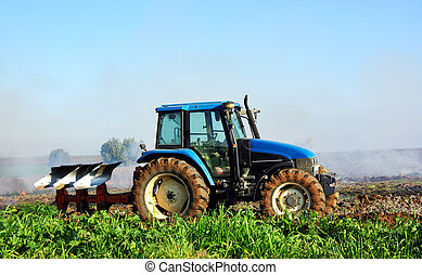 Blue tractor in portuguese field