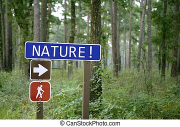 Blue traffic sign with nature message in the green forest