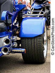 blue trike metal details close up - rear side of a blue...