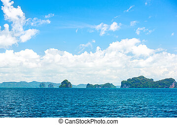 blue tropical ocean and clouds on sky with island, panorama, travel destination, Phuket, Thailand