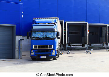 Blue truck at loading docks
