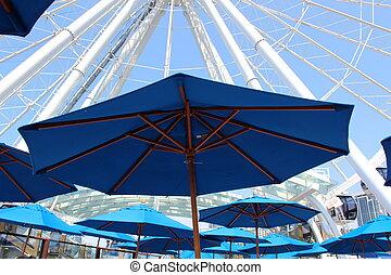 Blue Umbrellas and Ferris Wheel