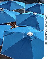 Blue Umbrellas - Patio umbrellas on a Cruise Ship bar area