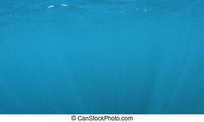 Blue underwater showing surface