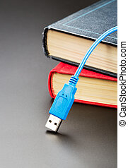 Blue usb cable on books
