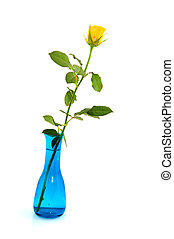 Blue vase with yellow rose