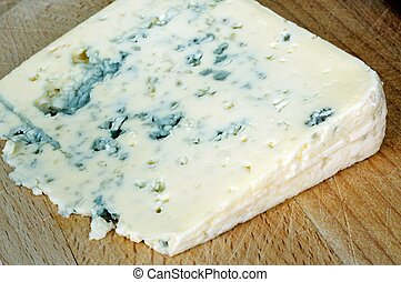 Blue veined cheese wedge. - French Bleu d'Auvergne cheese on...