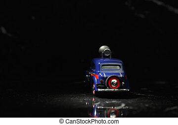 Blue vintage car in spot