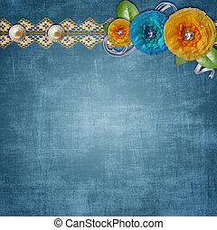 Blue vintage textured background with a bouquet of paper flowers, lace and pearls
