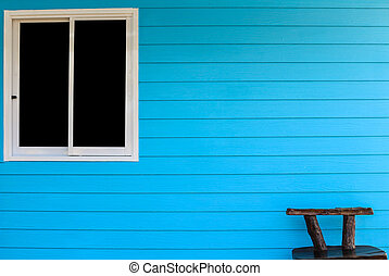 blue wall background with window