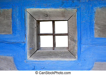 Blue wall of the house with a window
