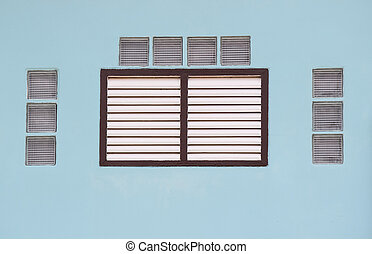 Blue wall with window.