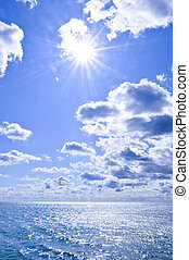 Blue water and sunny sky background - Blue ocean water and...