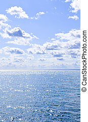 Blue water and sunny sky background