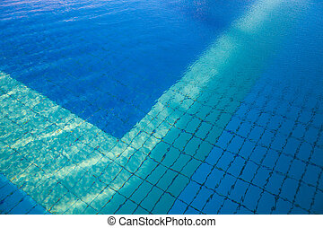 Blue water in a swimming pool